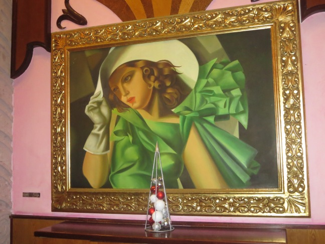 A GIRL IN GREEN WITH GLOVES by Tamara De Lempicka